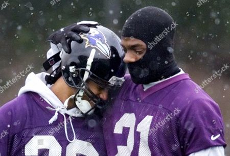 MCALISTER STARKS Bundled up against the falling snow, Baltimore Ravens cornerback Chris McAlister, right, playfully embraces fellow Ravens cornerback Duane Starks during practice at the team's facility in Owings Mills, Md. . The Ravens meet the New York Giants in the Super Bowl in Tampa, Fla., Sunday, Jan. 28, 2001