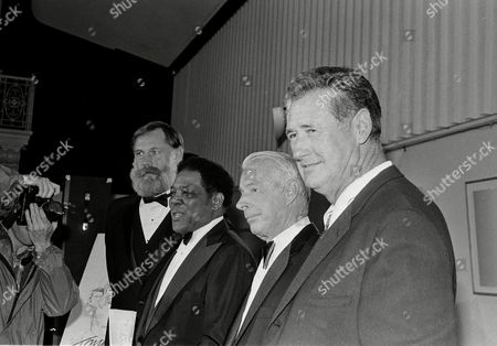 Ben Davidson, Willie Mays, Joe DiMaggio, Ted Williams From left: Ben Davidson, former NFL player; and baseball all stars Willie Mays, Joe DiMaggio, and Ted Williams, pose prior to a benefit for Tony Conigliaro at Symphony Hall in Boston, Mass., . Conigliaro was incapacitated by a massive heart attack and the benefit seeks to offset some of the medical costs