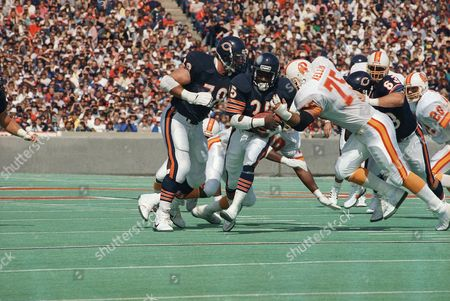 Walter Payton, Kevin Kellin Chicago Bears Walter Payton (34) pulls the football in tight as he drives through the arms of Tampa Bay Buccaneers Kevin Kellin (75) and Rod Jones (22) for a gain of ten yards in the first quarter of game, in Chicago. Payton scored two touchdowns, one of a 1-yard dive for his NFL record 107th rushing TD and another on a 9-yard pass during the game. The Bears won 20-3