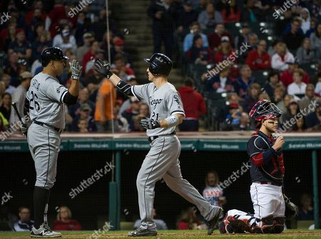 Todd Frazier, Avisail Garcia, Roberto Perez Chicago White Sox's Todd Frazier is greeted by Avisail Garcia after hitting a home run off Cleveland Indians relief pitcher Perci Garner during the sixth inning of a baseball game in Cleveland, . Indians catcher Roberto Perez is shown in the background