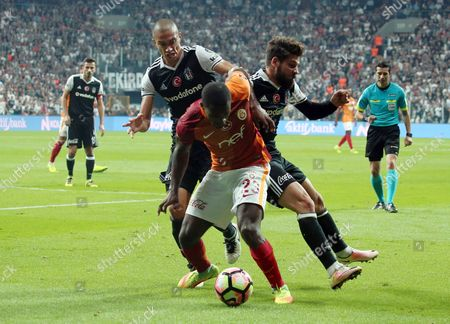 Lionel Carole, Gokhan Inler, Olcay Sahan Galatasaray's Lionel Carole, front, and Gokhan Inler, left, and Olcay Sahan of Besiktas fight for the ball during their Turkish League soccer derby match at the Vodafone Arena Stadium in Istanbul, Turkey