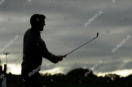 Europe's Chris Woods hits a shot on the driving range during a practice round for the Ryder Cup golf tournament, at Hazeltine National Golf Club in Chaska, Minn