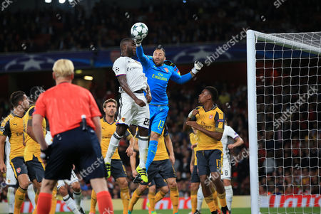 Stock Picture of David Ospina of Arsenal makes a save from Eder Alvarez Balanta of FC Basel during Arsenal vs FC Basel, UEFA Champions League Football at the Emirates Stadium on 28th September 2016