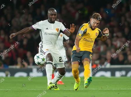 Alex Oxlade-Chamberlain of Arsenal is pressured by Eder Alvarez Balanta of FC Basel, UEFA Champions League, The Emirates Stadium, London, Britain
