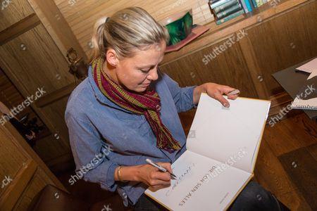 Stock Image of Viviane Sassen signing her books