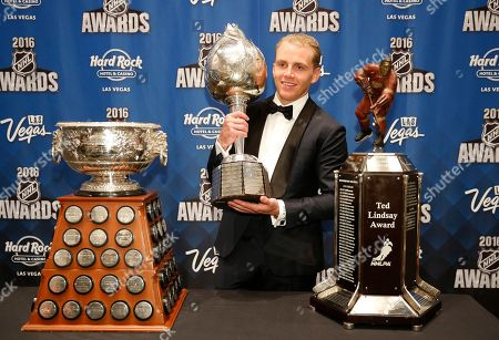 Chicago Blackhawks' Patrick Kane poses with the Art Ross Trophy, left, the Hart Trophy, center, and the Ted Lindsay Award after winning the awards at the NHL Awards show, in Las Vegas