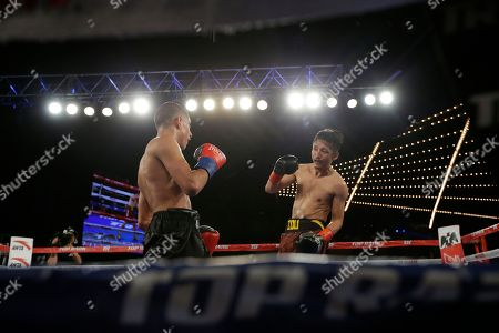 Jozsef Ajtai, Zou Shiming Zou Shiming, of China, left, fights Jozef Ajtai, of Hungary, during the fourth round of a WBO flyweight title boxing match, in New York. Zou Shiming, of China, won the fight