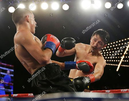 Jozsef Ajtai, Zou Shiming Zou Shiming, right, of China, punches Jozef Ajtai, of Hungary, during the third round of a WBO flyweight title boxing match, in New York. Zou won the fight