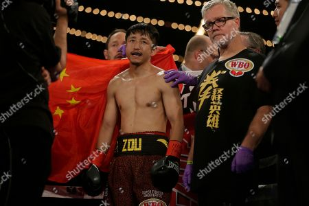 Freddie Roach, Zou Shiming Boxing trainer Freddie Roach, right, stands with Zou Shiming, of China, before a WBO flyweight title boxing against Jozef Ajtai, of Hungary, in New York. Zou Shiming, of China, won the fight