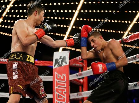 Jozsef Ajtai, Zou Shiming Zou Shiming, left, of China, punches Jozef Ajtai, of Hungary, during the second round of a WBO flyweight title boxing match, in New York. Zou won the fight