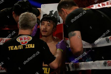 Freddie Roach, Zou Shiming Boxing trainer Freddie Roach, left, talks to Zou Shiming, of China, before the second round of a WBO flyweight title boxing against Jozef Ajtai, of Hungary, in New York. Zou Shiming, of China, won the fight