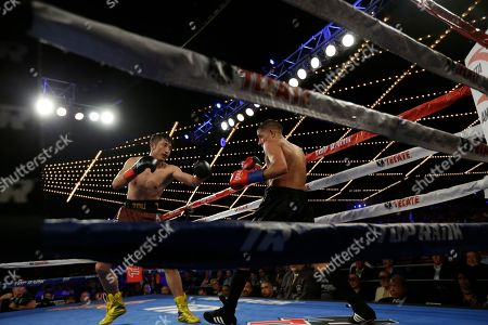 Jozsef Ajtai, Zou Shiming Zou Shiming, of China, left, fights Jozef Ajtai, of Hungary, during the second round of a WBO flyweight title boxing match, in New York. Zou Shiming, of China, won the fight