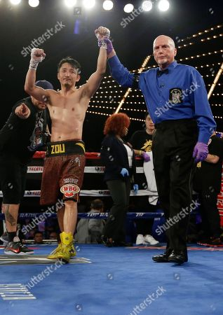 Zou Shiming Zou Shiming, left, of China, celebrates after a WBO flyweight title boxing match against Jozef Ajtai, of Hungary, in New York. Zou won the fight