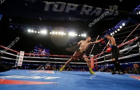 Jozsef Ajtai, Zou Shiming Zou Shiming, of China, punches Jozef Ajtai, of Hungary, during the fourth round of a WBO flyweight title boxing match, in New York. Zou won the fight