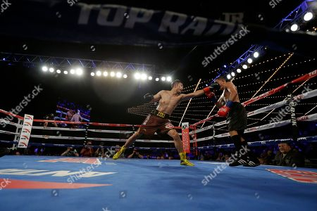 Jozsef Ajtai, Zou Shiming Zou Shiming, of China, punches Jozef Ajtai, of Hungary, during the fourth round of a WBO flyweight title boxing match, in New York. Zou Shiming, of China, won the fight
