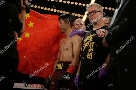 Jozsef Ajtai, Zou Shiming Boxing trainer Freddie Roach, right, stands with Zou Shiming, of China, before a WBO flyweight title boxing against Jozef Ajtai, of Hungary, in New York. Zou Shiming, of China, won the fight