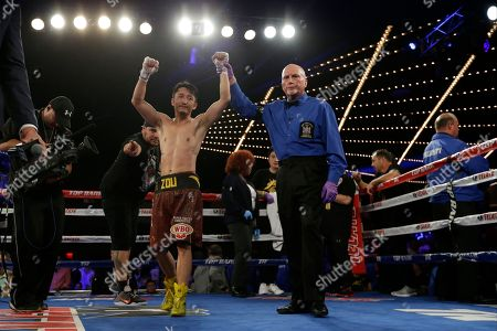 Zou Shiming Zou Shiming, of China, celebrates after a WBO flyweight title boxing match against Jozef Ajtai, of Hungary, in New York. Zou Shiming, of China, won the fight