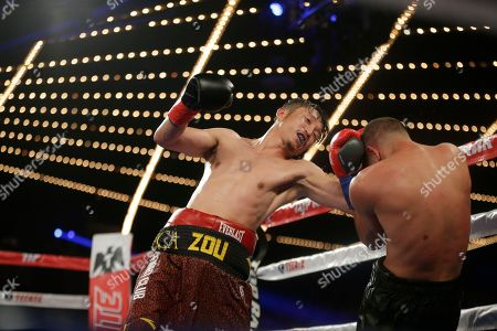 Jozsef Ajtai, Zou Shiming Zou Shiming, of China, punches Jozef Ajtai, of Hungary, during the eighth round of a WBO flyweight title boxing match, in New York. Zou Shiming, of China, won the fight