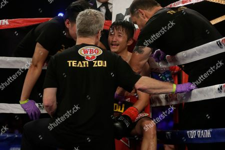 Jozsef Ajtai, Zou Shiming Zou Shiming, of China, smiles while talking to Boxing trainer Freddie Roach, before the start of the ninth round of a WBO flyweight title boxing match against Jozef Ajtai, of Hungary, in New York. Zou Shiming, of China, won the fight
