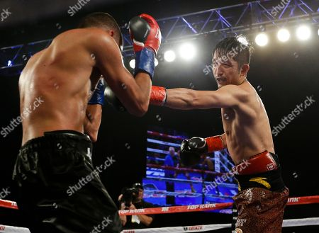 Jozsef Ajtai, Zou Shiming Zou Shiming, right, of China, punches Jozef Ajtai, of Hungary, during the tenth round of a WBO flyweight title boxing match, in New York. Zou won the fight