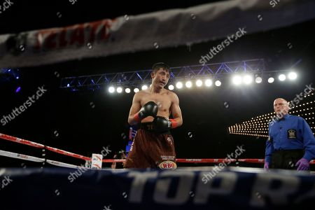 Jozsef Ajtai, Zou Shiming Zou Shiming, of China, fights Jozef Ajtai, of Hungary, during the second round of a WBO flyweight title boxing match, in New York. Zou Shiming, of China, won the fight