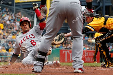 Yunel Escobar, Chris Stewart Los Angeles Angels' Yunel Escobar (6) slides safely past the tag of Pittsburgh Pirates catcher Chris Stewart, right, on a sacrifice fly to right field by Albert Pujols during the first inning of a baseball game in Pittsburgh