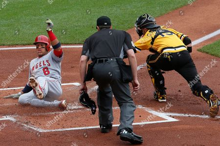 Yunel Escobar, Chris Stewart Los Angeles Angels' Yunel Escobar (6) slides safely past the tag of Pittsburgh Pirates catcher Chris Stewart, right, on a sacrifice fly to right field by Albert Pujols during the first inning of a baseball game in Pittsburgh, . Making the call on the play is umpire Lance Barrett