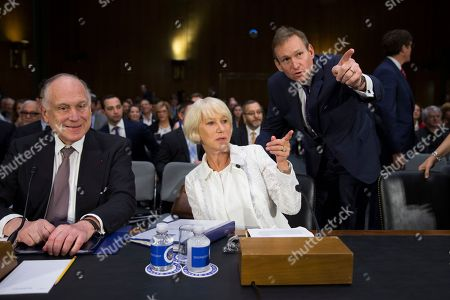 Helen Mirren, Ronald Lauder From left. former Ambassador to Austria Ronald Lauder and actress Dame Helen Mirren, talks with an aide on Capitol Hill in Washington, during a Senate Judiciary subcommittee hearing on the Holocaust Expropriated Art Recovery Act