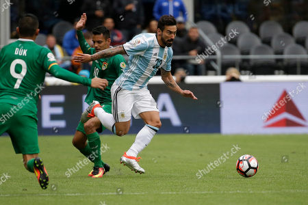 Argentina's Ezequiel Lavezzi, right, fights for the ball against Bolivia's Yasmani Duk, left, and Jhasmany Campos during a Copa America Centenario Group D soccer match, at CenturyLink Field in Seattle