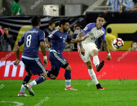 United States's Geoff Cameron (20) is defended by Argentina's Ezequiel Lavezzi (22) during a Copa America Centenario semifinal soccer match, in Houston