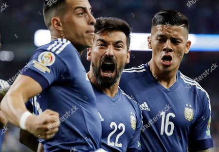 Ramiro Funes Mori, Ezequiel Lavezzi, Marcos Rojo Argentina's Ezequiel Lavezzi (22) celebrates his goal against the United States with Ramiro Funes Mori, left, and defender Marcos Rojo (16) during a Copa America Centenario soccer semifinal, in Houston