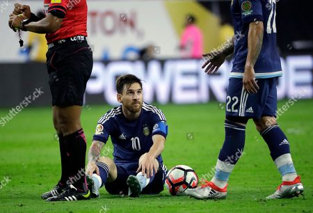 Argentina's Lionel Messi (10) is helped by teammate Ezequiel Lavezzi (22) during a Copa America Centenario semifinal soccer match against the United States, in Houston