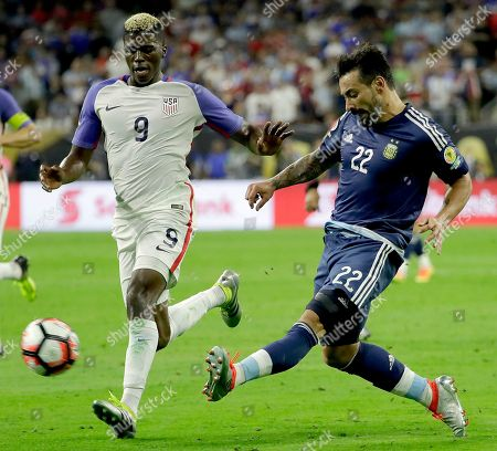 Argentina Ezequiel Lavezzi (22) kicks the ball past United States Gyasi Zerdes (9) during a Copa America Centenario semifinal soccer match, in Houston