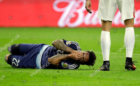 Argentina Ezequiel Lavezzi (22) goes down after a collision with United States goalkeeper Brad Guzan during a Copa America Centenario semifinal soccer match, in Houston