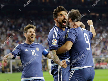 Gonzalo Higuain Argentina's Gonzalo Higuain (9) celebrates his goal against the United States with Lionel Messi, left, and Ezequiel Lavezzi, center, during a Copa America Centenario soccer semifinal, in Houston. Argentina won 4-0