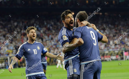 Gonzalo Higuain Argentina forward Gonzalo Higuain (9) celebrates his goal against the United States with midfielder Lionel Messi, left, and forward Ezequiel Lavezzi, center, during a Copa America Centenario semifinal soccer match, in Houston. Argentina won 4-0