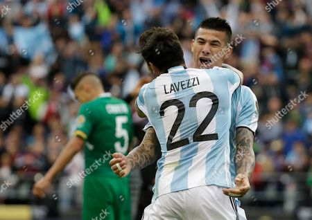 Victor Cuesta, Ezequiel Lavezz Argentina's Victor Cuesta, right, is congratulated by Ezequiel Lavezzi after scoring his side's third goal against Bolivia during a Copa America Centenario Group D soccer match, at CenturyLink Field in Seattle