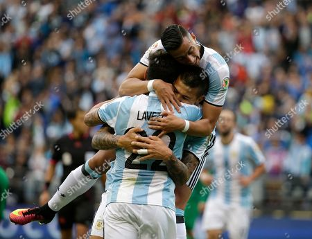 Victor Cuesta, Ezequiel Lavezzi, Ramiro Funes Mori Argentina's Victor Cuesta, center, is congratulated by Ezequiel Lavezzi (22) and Ramiro Funes Mori after scoring his side's third goal against Bolivia during a Copa America Centenario Group D soccer match, at CenturyLink Field in Seattle