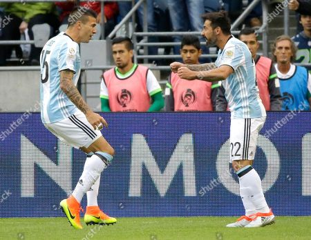 Victor Cuesta Argentina defender Victor Cuesta, left, celebrates after he scored a goal against Bolivia with an assist from Ezequiel Lavezzi, right, during the first half of a Copa America Centenario soccer match, in Seattle