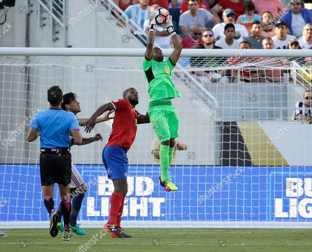 Patrick Pemberton Costa Rica's goalkeeper Patrick Pemberton, right, stops a shot on goal by Paraguay during the second half of a Copa America group A soccer match at Camping World Stadium, in Orlando, Fla. The match ended in a 0-0 tie