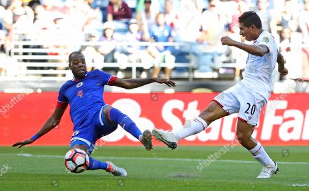 Edison Flores Peru forward Edison Flores, right, shoots past Haiti defender Kim Jaggy, left, in the first half of a Copa America Centenario soccer match, in at CenturyLink Field in Seattle