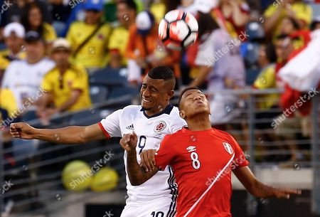 Colombia's Farid Diaz, left, and Peru's Andy Polo (8) vie for the ball in the first half of a Copa America Centenario quarterfinal soccer match, in East Rutherford, N.J