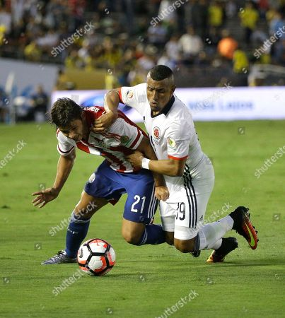 Farid Diaz, Oscar Romero Colombia's Farid Diaz, right, and Paraguay's Oscar Romero fight for the ball during the first half of a Copa America Centenario Group A soccer match at the Rose Bowl, in Pasadena, Calif