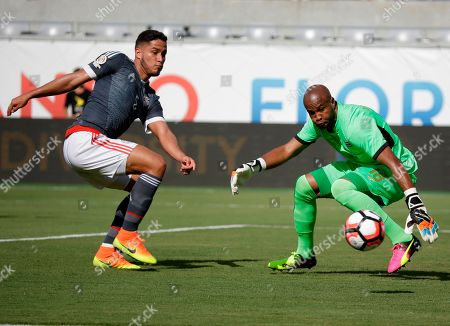 Patrick Pemberton, Bruno Valdez Costa Rica goalkeeper Patrick Pemberton (18) deflects a shot by Paraguay's Bruno Valdez, left, during the first half of a Copa America group A soccer match at Camping World Stadium, in Orlando, Fla