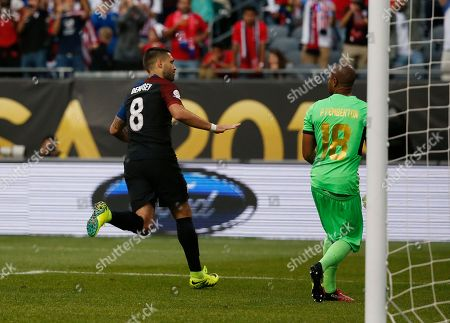 United States' Clint Dempsey (8) celebrates after kicking a goal against Costa Rica's Patrick Pemberton (18) during a Copa America Centenario group A soccer match at Soldier Field in Chicago
