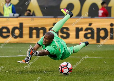 Costa Rica's Patrick Pemberton (18) dives but cannot make a save on a shot by United States' Jermaine Jones (13) during a Copa America Centenario group A soccer match at Soldier Field in Chicago