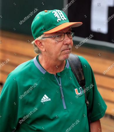Jim Morris Miami coach Jim Morris leaves the dugout following the team's 5-3 loss to UC Santa Barbra in an NCAA College World Series baseball game, in Omaha, Neb