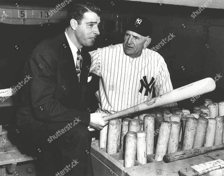 DIMAGGIO STENGEL New York Yankees center fielder Joe DiMaggio speaks with manager Casey Stengel in the dugout in this undated photo