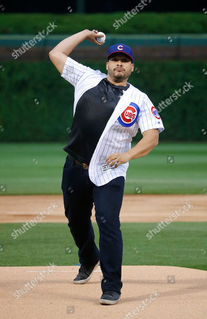 "Joe Minoso Actor Joe Minoso, from the television series ""Chicago Fire,"" throws out a ceremonial first pitch before a baseball game between the Chicago Cubs and the Los Angeles Dodgers, in Chicago"