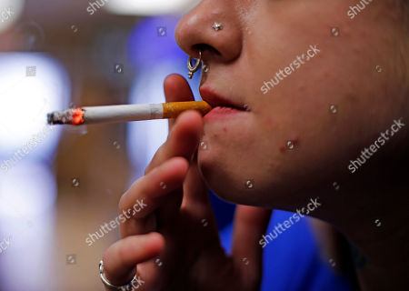 Stock Photo of Altria; Marlboro; smoking; cigarettes Store manager Stephanie Hunt smokes a Marlboro cigarette while posing for photos at a Smoker Friendly shop in Pittsburgh. Altria Group Inc., maker of Marlboro cigarettes, reports financial results on